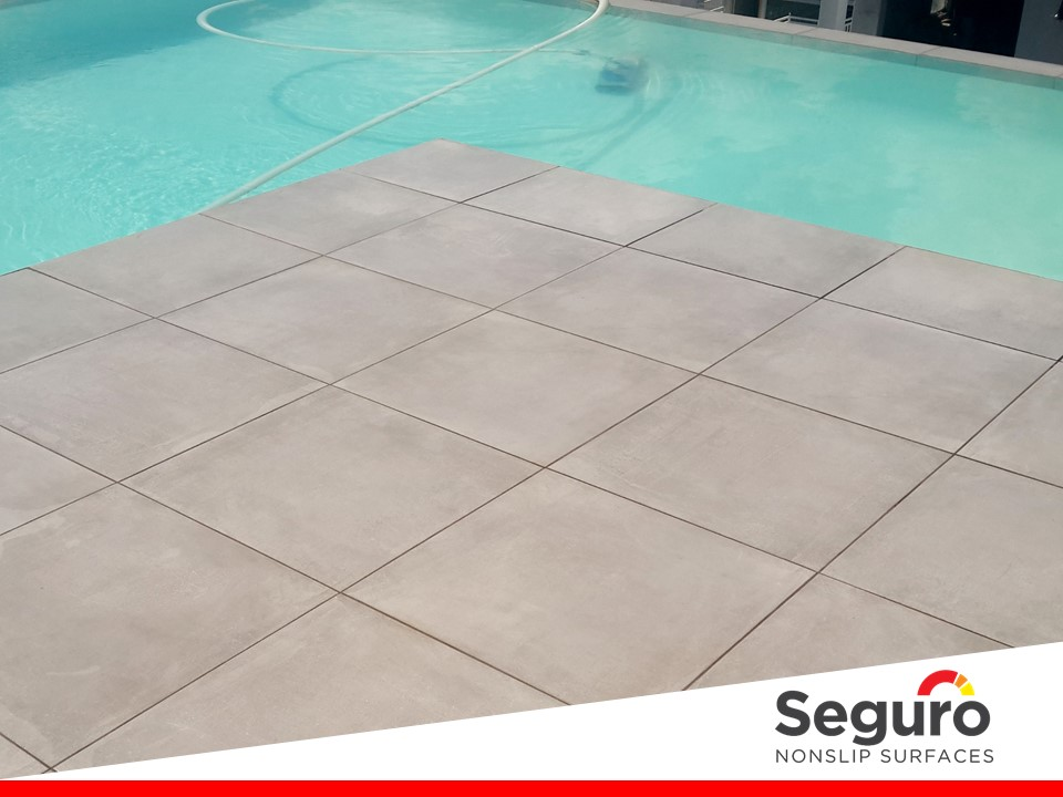 Anti-slip coating on porcelain tiles around pool
