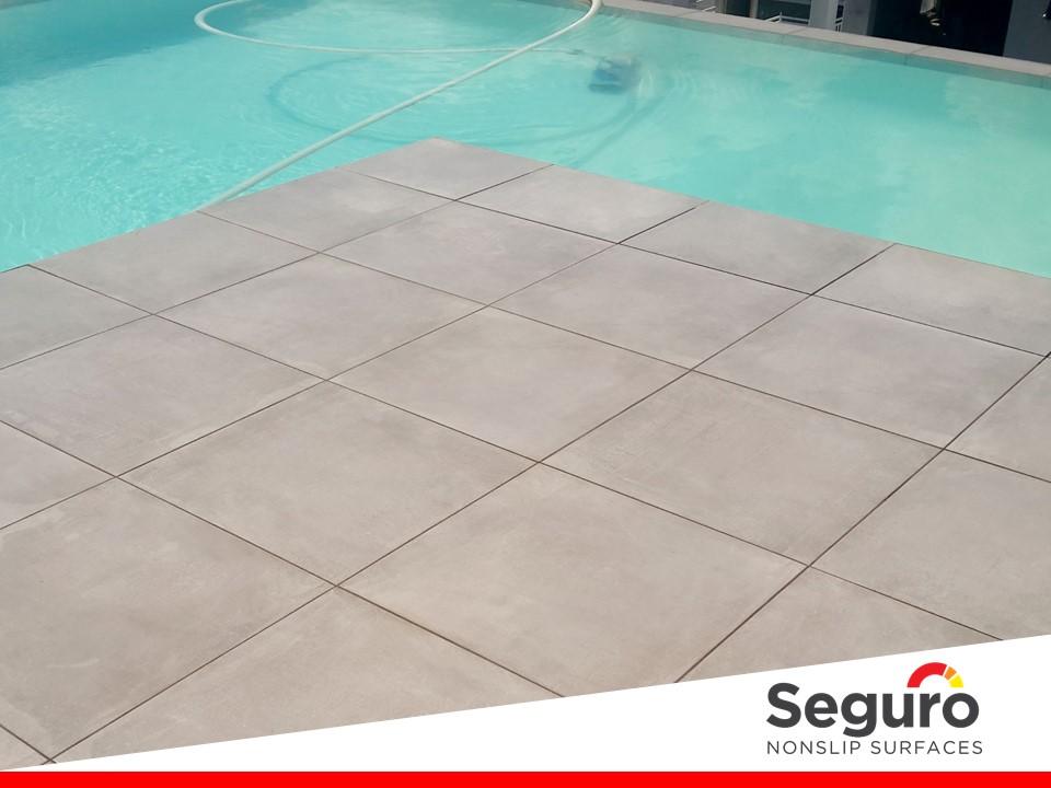 Anti-slip coating on porcelain tiles around pool